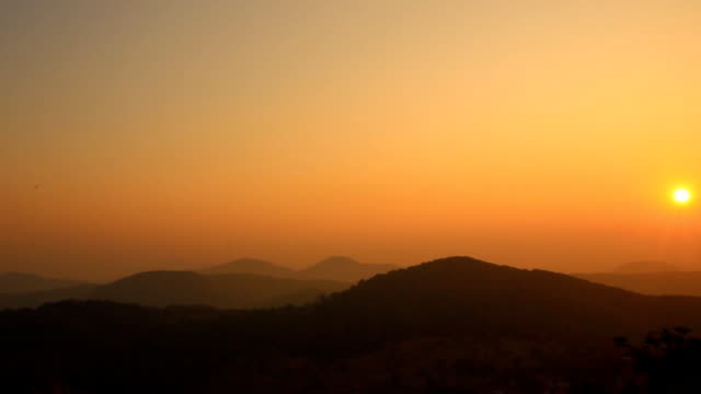 Sunrise or sunset over mountain. video