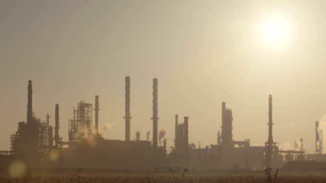 Sunrise over a large oil refinery video