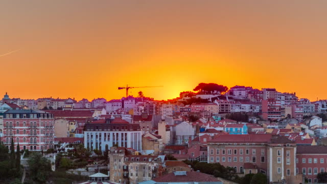 Sunrise over Lisbon aerial cityscape skyline timelapse from viewpoint of St. Peter of Alcantara, Portugal