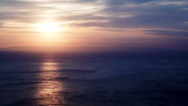 sunrise over sea surface time lapse - пелопоннес стоковые видео и кадры b-roll