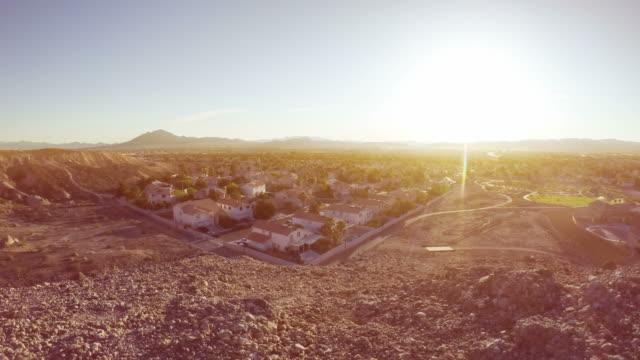 sunrise over southwestern suburban neighborhood time lapse - las vegas video stock e b–roll