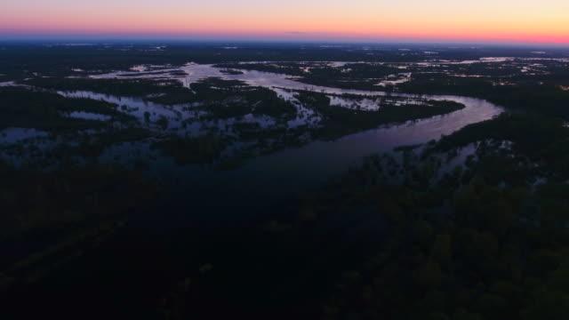 sunrise over spilling of the pripyat river. flying over the river. - славянская культура стоковые видео и кадры b-roll