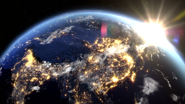 Sunrise over the earth seen from space.Close up of china - Asia zone.with night time and sunrise 4K. video