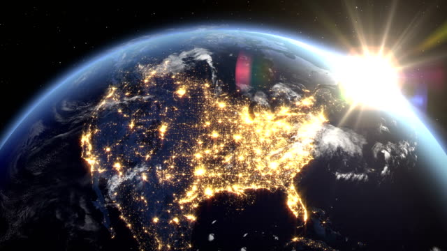 Sunrise over the earth seen from space.Close up of USA zone with night time and sunrise 4K.