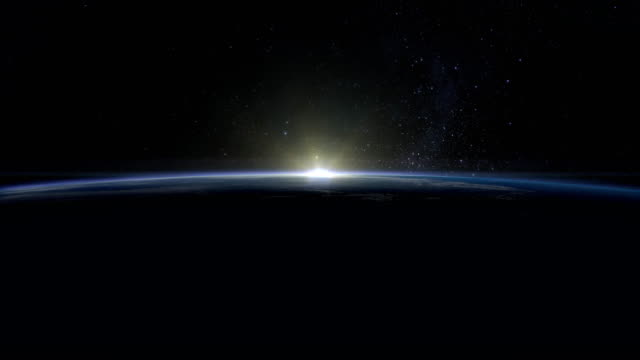 Sunrise over the Earth. The earth rotates quickly. Volumetric clouds. View from space. Beautiful starry sky. 4K.