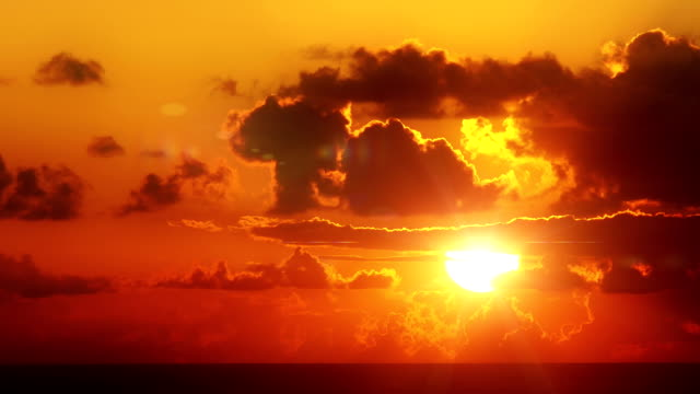 Sunrise over the ocean Sunrise over the ocean. Nature background. Time lapse. Backlit and cloudscape. brightly lit stock videos & royalty-free footage