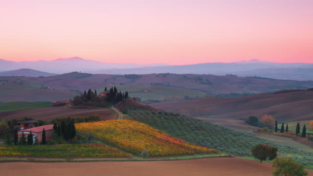 Sunrise over Tuscan Hills. Time Lapse UHD video