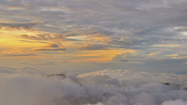 Sunrise panorama on sky and clouds from mountain top at Adam's Peak, travel destination in Sri Lanka video
