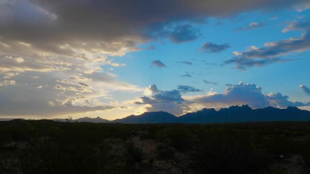vidéos et rushes de sunrise reveal on mountains from bushes - inclinaison vers le haut