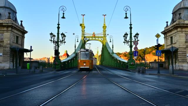 Sunrise Scene of Budapest tram public transport with Liberty bridge, Budapest, Hungary Sunrise Scene of Budapest tram public transport with Liberty bridge, Budapest, Hungary hungary stock videos & royalty-free footage