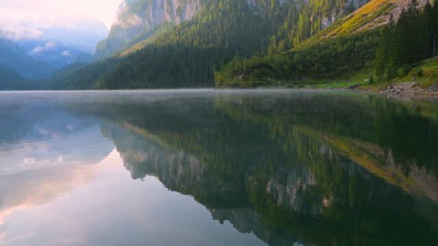sunrise scene with morning fog around gosauseen lake, splendid morning view of austrian alps, upper austria, europe - stato federato del tirolo video stock e b–roll