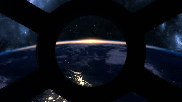 Sunrise seen from ISS window Sunrise over Earth seen from International Space Station window side lit stock videos & royalty-free footage
