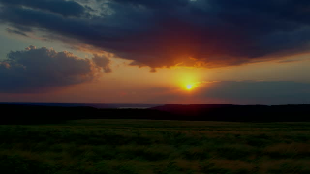 Sunrise sky clouds Time lapse over a wheat agriculture field, HDR RAW shots 4K video