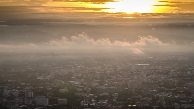 Sunrise Time Lapse with City of mist time-lapse , chiang mai city with mist in the morning after sunrise formation of cloud , UHD Format video