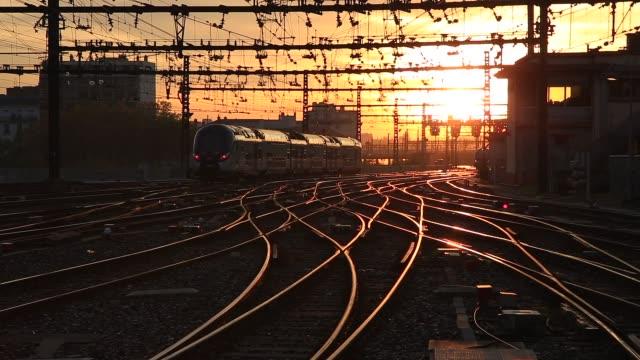 Sunrise train Train leaving a train station during a colorful sunrise. Perrache, Lyon. railroad track stock videos & royalty-free footage