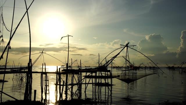 sunrise with fishing trap in pak pra village, Phatthalung Thailand. video