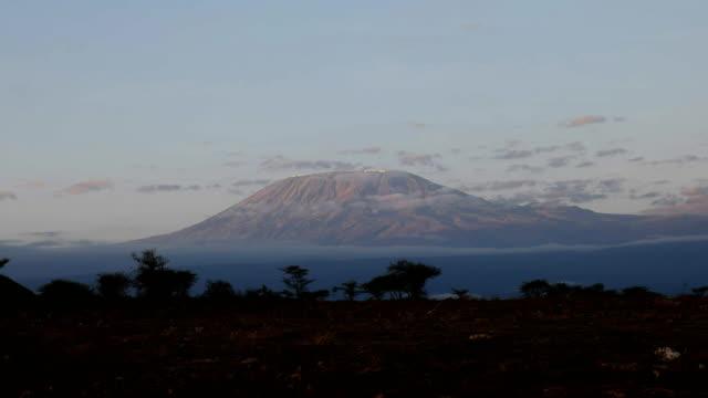 sunrise zoom in shot of mt kilimanjaro at amboseli