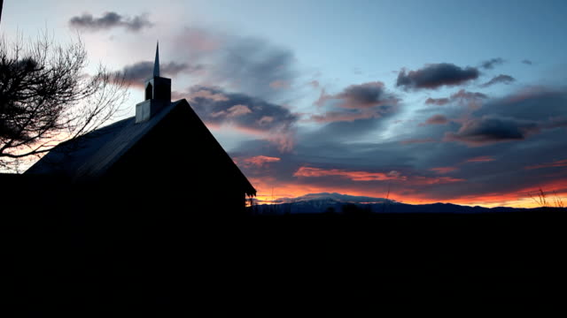 Sunrises behind rural church