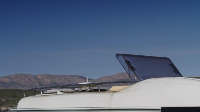 stockvideo's en b-roll-footage met zonnedak, raisable venster op dak bovenkant van kampeerauto - caravan