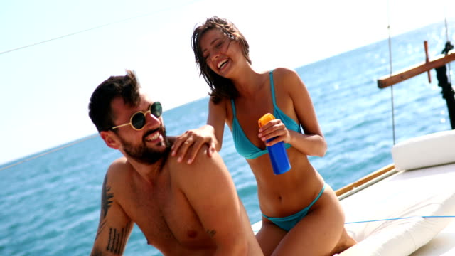 sunscreen is a must have. - sun cream stock videos & royalty-free footage