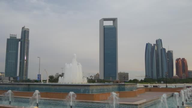 sunset abu dhabi city marina fountain famous towers panorama 4k united arab emirates - uae national day стоковые видео и кадры b-roll