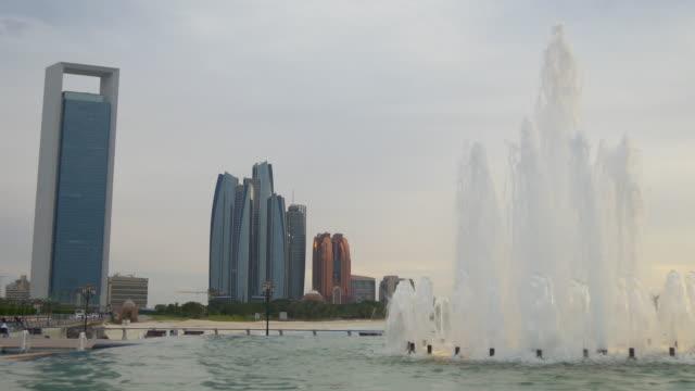 sunset abu dhabi marina fountain famous towers panorama 4k united arab emirates - uae national day стоковые видео и кадры b-roll