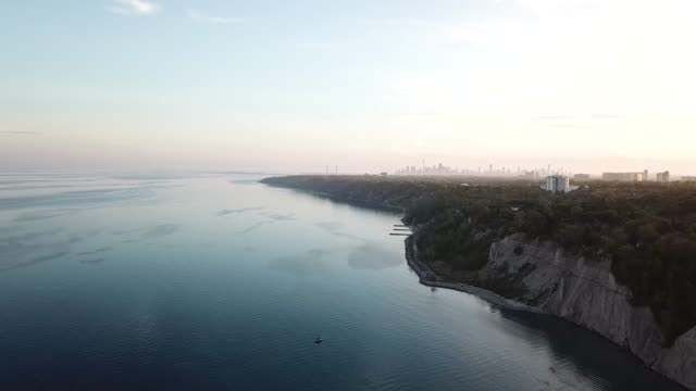 Sunset aerial view of Scarborough's Bruffer's park with a far background in Toronto downtown. Sunset aerial view of Scarborough's Bruffer's park with a far background in Toronto downtown. cliffs stock videos & royalty-free footage