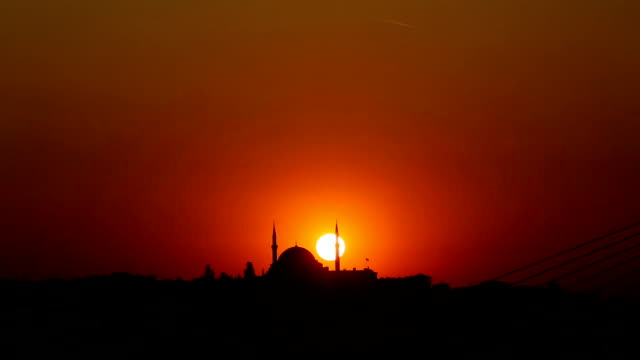 sunset and mosque sunset and silhouette of a mosque in Istanbul aegean turkey stock videos & royalty-free footage
