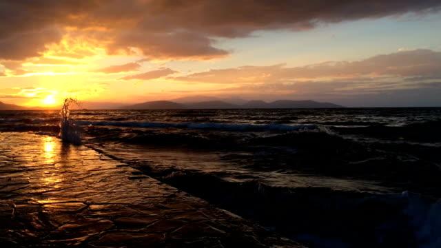 Sunset And Sea Sea and sunset in Guzelcamli, Davutlar, Aydin, Turkey. aegean sea stock videos & royalty-free footage