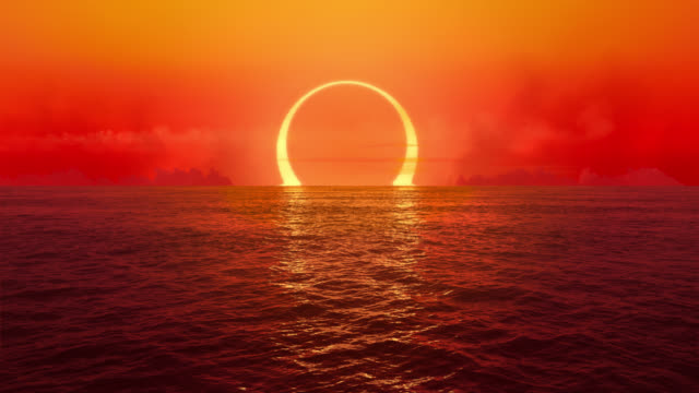 sunset and solar eclipse over seamlessly looped ocean. - inferno video stock e b–roll