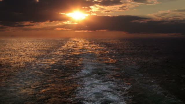 Sunset and wake of a ship video
