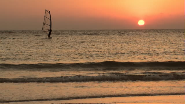 Sunset and windsurfing video