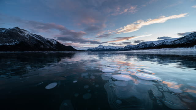 sunset at Abraham lake in winter with ice bubble