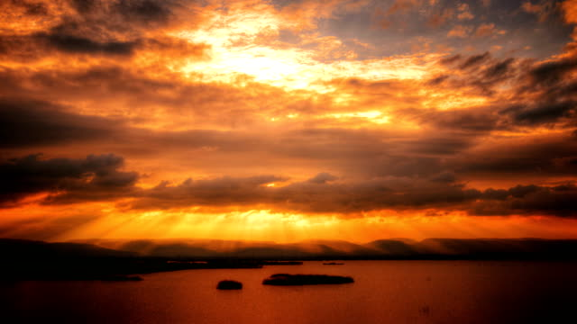 Sunset at Cloud Time Lapse 4K(HDR) 4K Time Lapse:Video formats Sunlight shimmering reaking through the clouds over mountain time lapse,High Dynamic Resolution Imaging. high dynamic range imaging stock videos & royalty-free footage