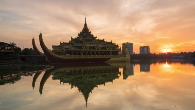 Sunset at Karaweik Palace ,Yangon Myanmar Sunset at Karaweik Palace ,Yangon Myanmar buddhism stock videos & royalty-free footage
