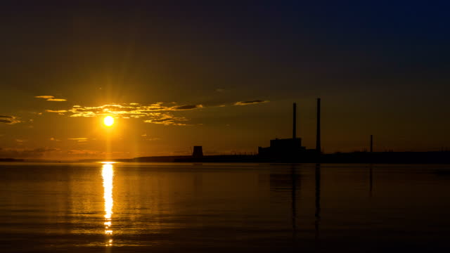 Sunset at power plant. Timelapse video