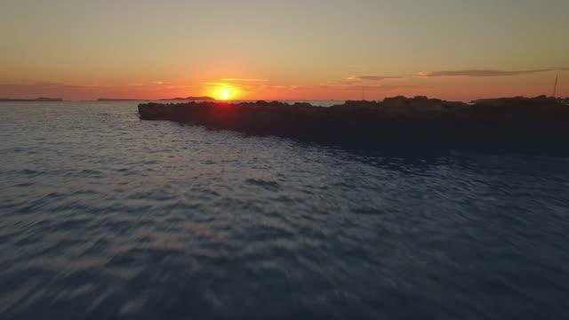 sunset at sant antoni de portmany - ibiza filmów i materiałów b-roll