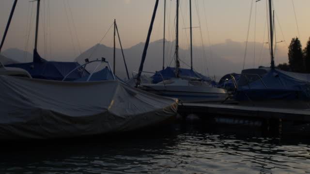 Sunset at the Lake Thun. Boats in the Marina. Jungfrau Region, Switzerland. video