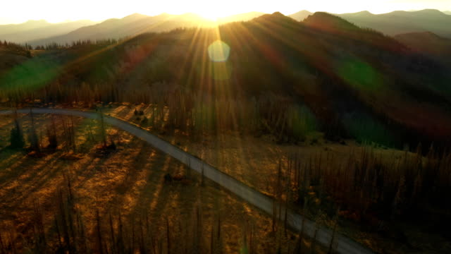 Sunset Beams over Road and Mountains by Drone Colorado, Drone - Sunset, Wilderness Roads and Sunset horizon over land stock videos & royalty-free footage