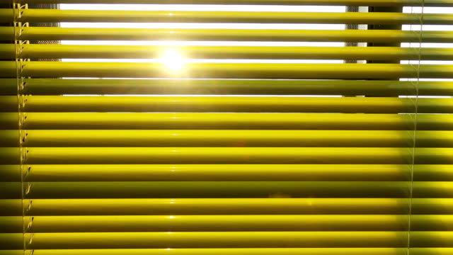 Sunset behind blinds