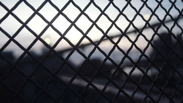 Sunset behind chain link fence