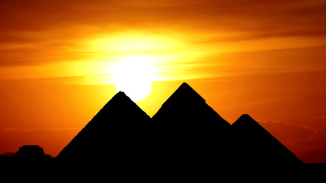 sunset behind great pyramids in Giza valley video
