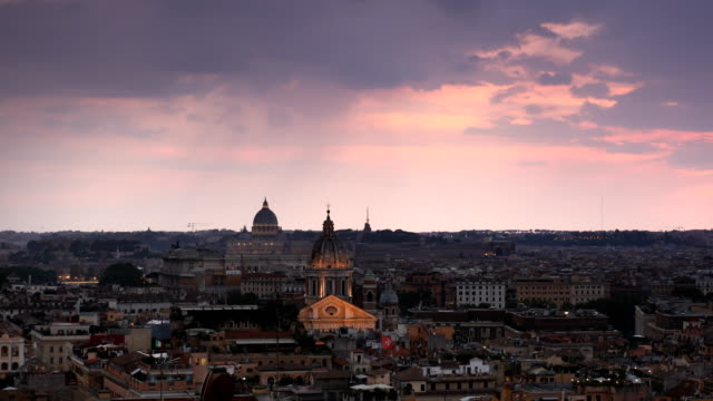stockvideo's en b-roll-footage met zonsondergang wolken boven rome - twilight