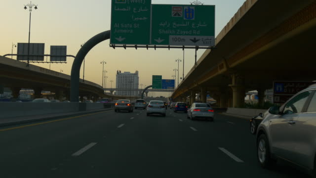 sunset evening dubai city traffic road pov driving car front panorama 4k united arab emirates video