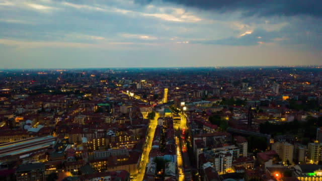 sunset illuminated milan cityscape famous canal aerial panorama 4k time lapse italy - milan video stock e b–roll