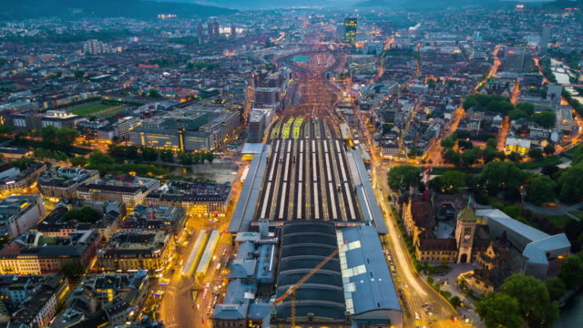 sunset illuminated zurich cityscape central train station aerial panorama 4k time lapse switzerland video