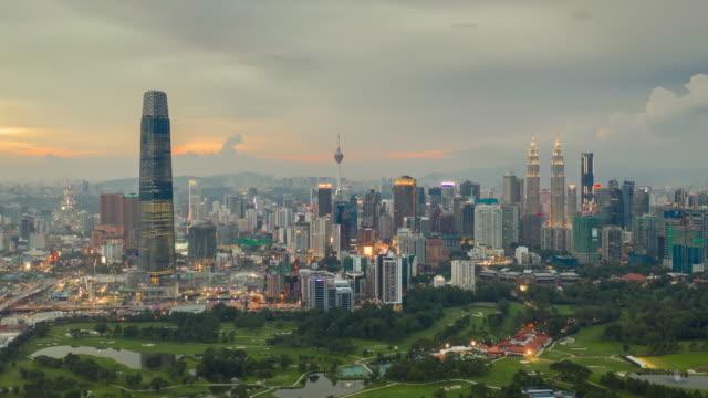 sunset illumination kuala lumpur city center golf course aerial topdown panorama 4k timelapse malaysia video
