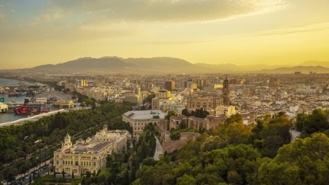 stockvideo's en b-roll-footage met zonsondergang in malaga stad, andalusië, spanje - spanje