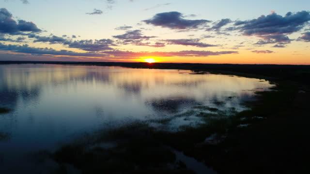 vídeos de stock e filmes b-roll de sunset in razna lake latvia at ligo time - letónia