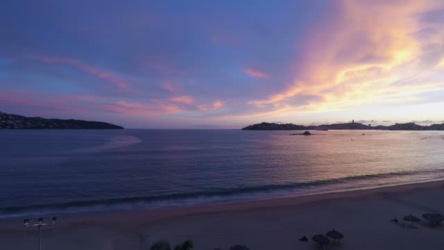 sunset in the bay of acapulco during the covid-19 pandemic - guerrero video stock e b–roll